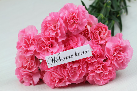 welcome home: Welcome home card with pink carnation flower bouquet
