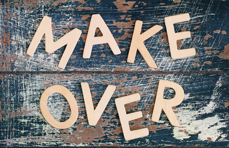 Makeover written with wooden letters on rustic wooden surface