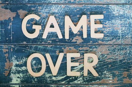 the game is over: Game over written with wooden letters on rustic wooden surface