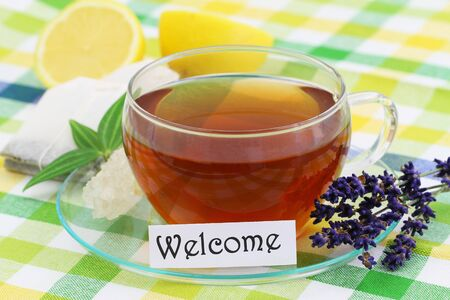 Welcome card with cup or lemon tea and lemon Reklamní fotografie