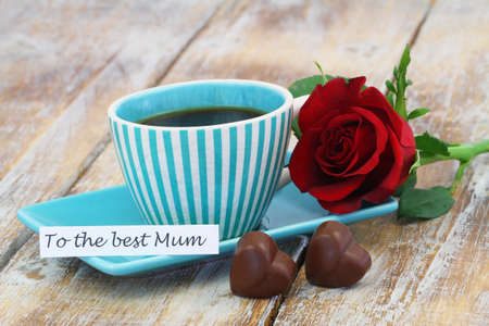 To the best mum card with cup of coffee, chocolate hearts and red rose Stock Photo