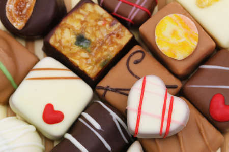 Background made or assorted chocolates and pralines