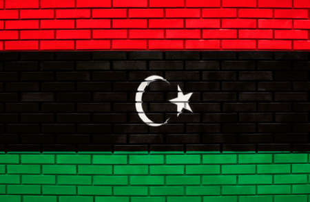 Flag of Libya on brick wall photo