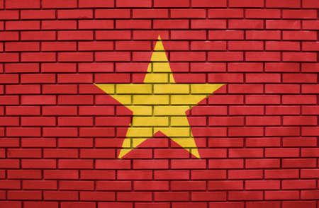 Flag of Wietnam on brick wall photo