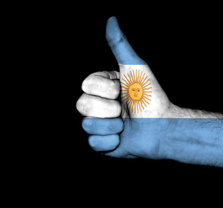 Flag of Argentina on hand photo