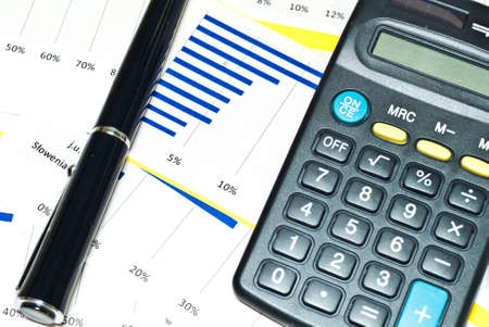 electronic balance: Charts profits of financial products and accessories Stock Photo