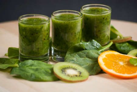 Healthy green Smoothie on wooden table photo