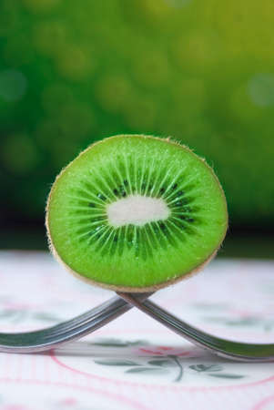 Fresh Kiwi fruit on forks photo