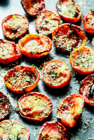 flavorsome: tomatoes baked in the oven with salt and basil Stock Photo