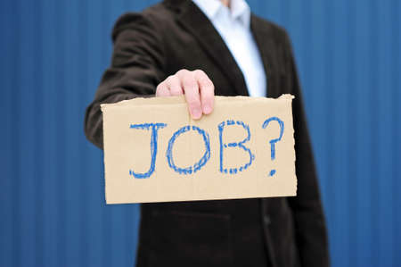 Man with sign looking for a job Stock Photo - 8564009