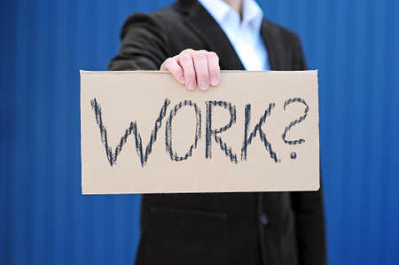 workless: Man with sign looking for work Stock Photo