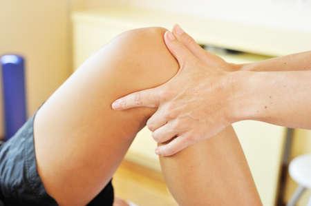 Physiotherapist examining a knee