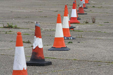 and worn out: Row of Old Traffic Cones