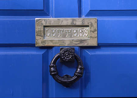 Blue Door and Brass Letterbox Stock Photo