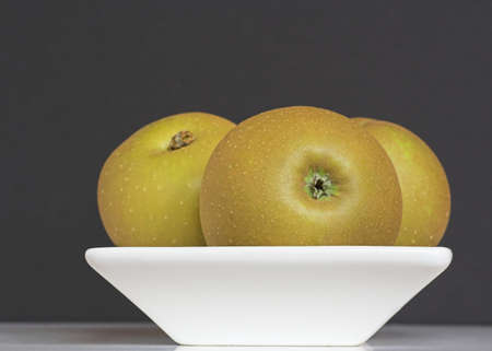 russet: Bowl of Russet Apples Stock Photo