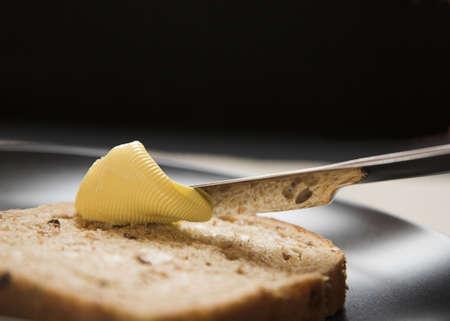 Bruin brood en boter Stockfoto