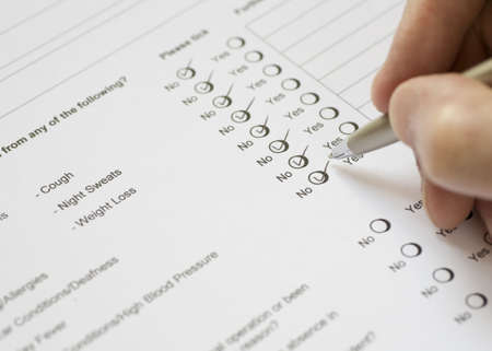 Applicant Completing Health Questionnaire Stock Photo - 2983478