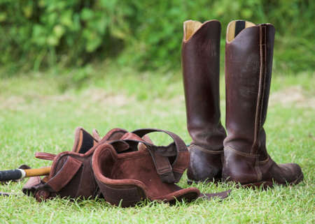 protectors: Pair of riding boots and knee protectors, ready for a game of polo.