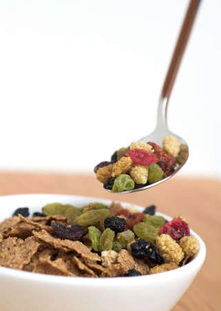 Healthy breakfast with bran flakes & dried fruit photo
