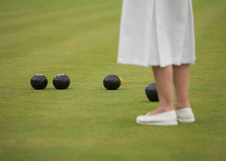 Female player in a game of lawn bowls.