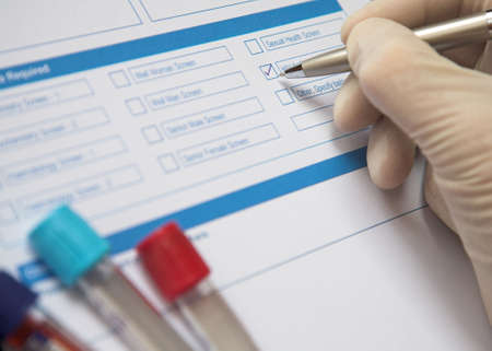 Doctor ticking box on a blood test form Stock Photo