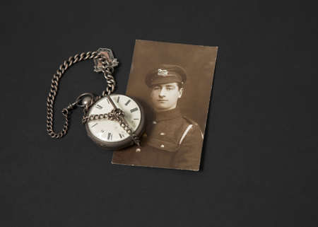 pocket watch: Photograph of a Great War veteran and antique pocket watch Stock Photo