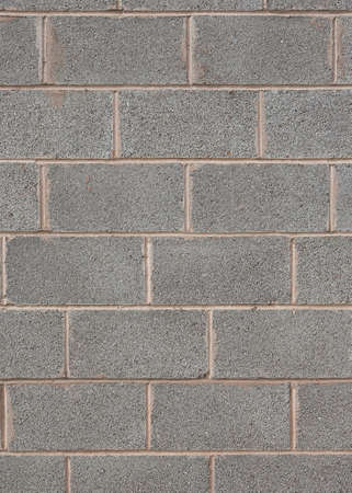 Closeup detail of a grey breeze block wall Stock Photo