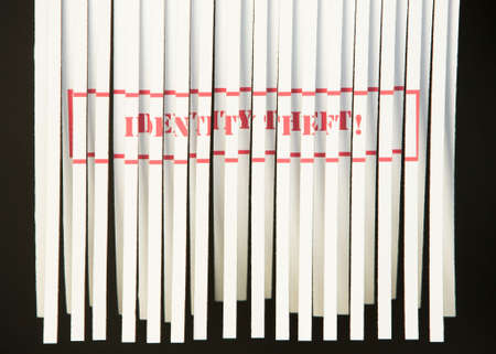 Shredding document with Identity Theft printed in red Stock Photo - 4615668
