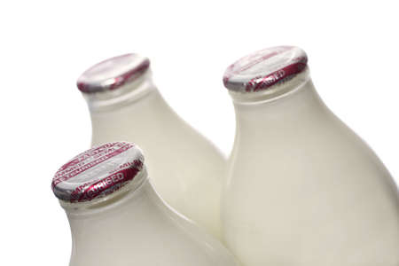 Three bottles of semi-skimmed milk on a white background