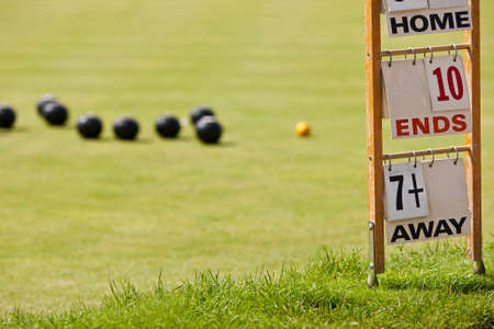 wood lawn: Bowling green with scorecard. Focus on the scorecard. Stock Photo