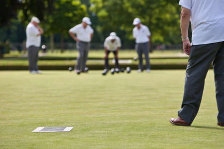 Men playing lawn bowls. Narrow depth of field.
