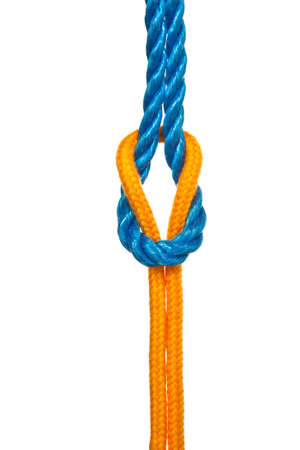 Two different ropes tied together with a reef knot or square knot - on a white background photo