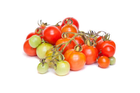 ripeness: A selection of tomatoes in varying stages of ripeness.