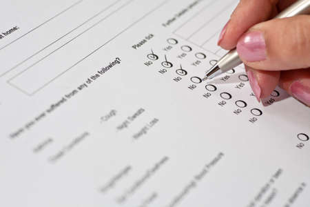 applicant: Female job applicant completing a health questionnaire