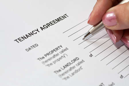 agreement: Lady completing a tenancy agreement form