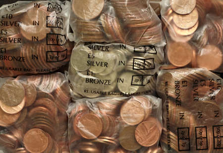 Bags of silver and bronze coins photo