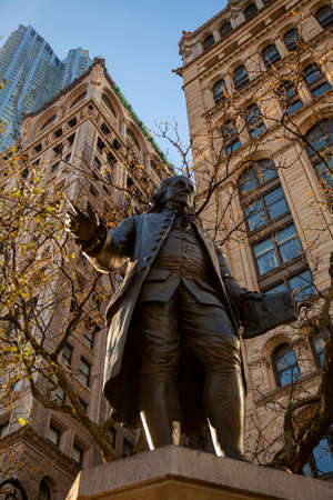 New York, USA 11/25/2017: Close up image of the Benjamin Franklin statue, located in lower Manhattan at a public park. This historical landmark was built in 1882 by Ernst Plassman.