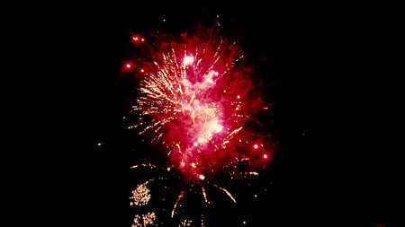 Close up isolated image of a firework show as multiple fireworks explode at the same time. Image features a colorful scene on dark night sky background.