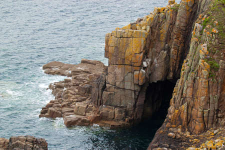 Rocky Atlantic coast of Cornwall with scenic rock formations.