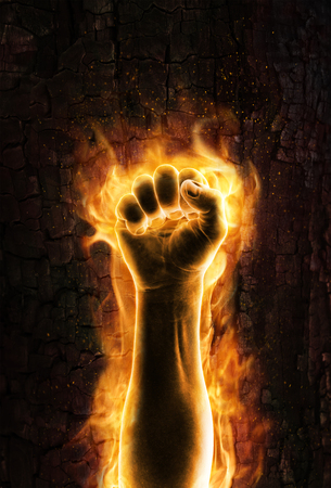 the human hand: Fist of fire  Grungy burning fist of fire