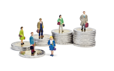 queueing: Miniature queue two euro stairs  Macro shot of male and female figurines queueing on stairs made of 2 euro coins