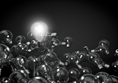 all in one: One bulb to rule them all  3D render of one glowing lightbulb above several dim ones Stock Photo