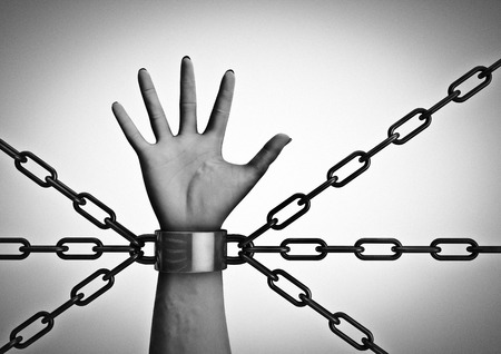 Shackled  3D render of shackled hand with multiple chains