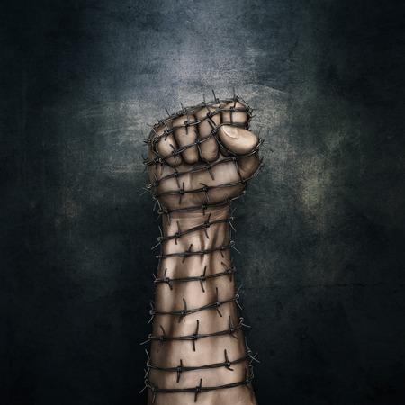 Stacheldraht Faust / 3D-Darstellung von grungy erhobener Faust im Stacheldraht vor einem dunklen Stein Hintergrund gewickelt
