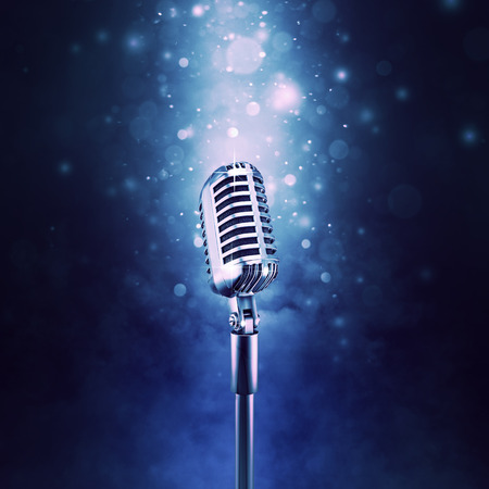 comedy: Retro microphone highlighted  3D illustration of old fashioned classic microphone on sparkly bokeh background