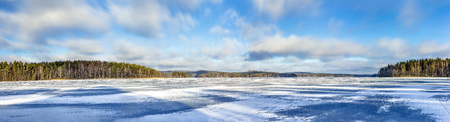 winter finland: Winter lake panorama Finland  Panoramic view over frozen lake in Finland in February 2017