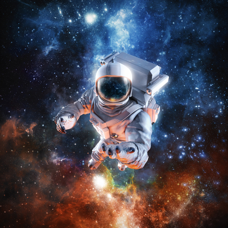 Science fiction scene with astronaut floating in outer space reaching with open hand towards viewer
