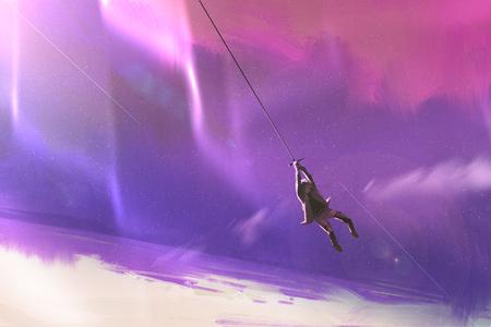 惑星地球の上のロープ スイングに掛かっている男