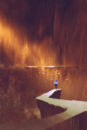 山の壁、道、絵画の図の終わりを見ている岩の道に立っている人の背面図 写真素材