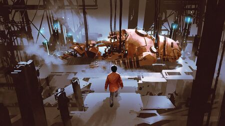 Boy walking to the broken giant robot which is being repaired in old factory 写真素材